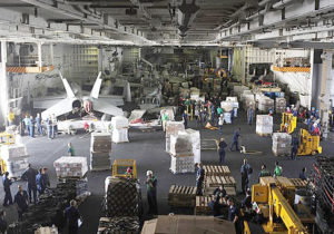 100204-N-6604E-124 GULF OF OMAN (Feb. 4, 2010) - Personnel and supplies fill the hangar bay of aircraft carrier USS Dwight D. Eisenhower (CVN 69) during an underway replenishment with fast combat support ship USNS Supply (T-AOE 6). Eisenhower is on a six-month deployment as a part of the on-going rotation of forward-deployed forces to support maritime security operations and operating in international waters around the globe, working with other coalition maritime forces. (U.S. Navy photo by Mass Communication Specialist 3rd Class Bradley Evans/Released).